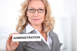 2547629-blond-office-worker-holding-administrator-badge