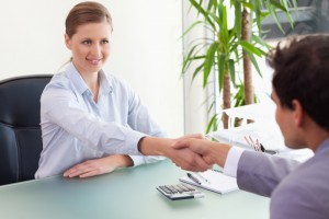 3609908-consultant-shaking-hands-with-her-client