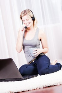 4298187-attractive-blond-woman-wearing-a-headset-and-fun